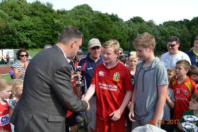 Irish Ambassador presenting winnning cup to U12-U15